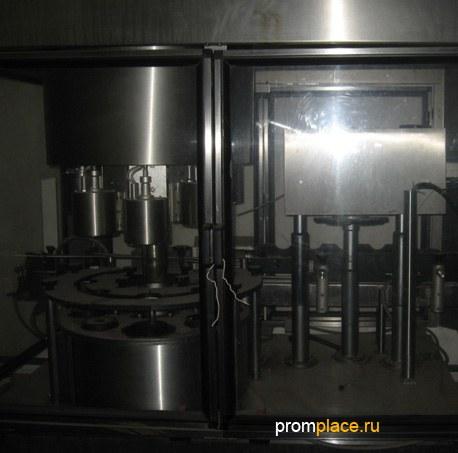 Автомат для нанесения и усадки термоусадочного колпачка