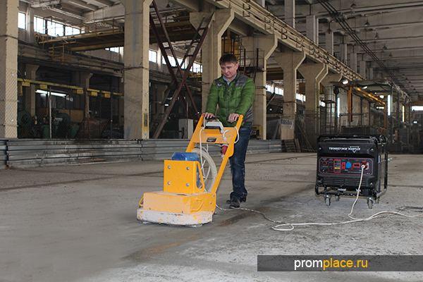 Обработка бетонного пола шлифовальной машиной